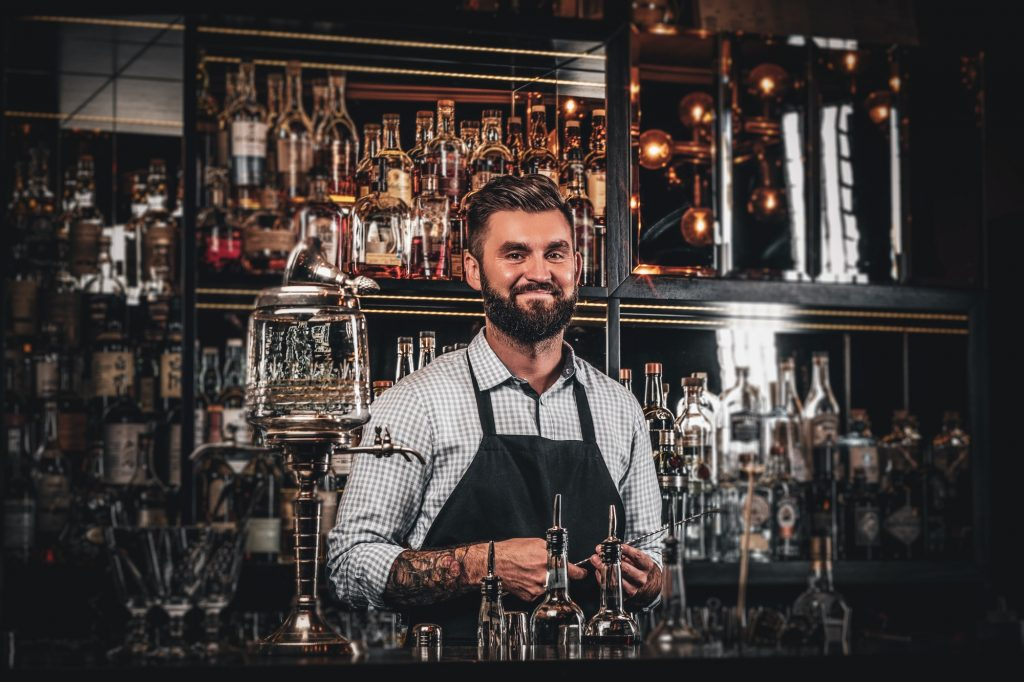 Handsome barman is posing for photographer